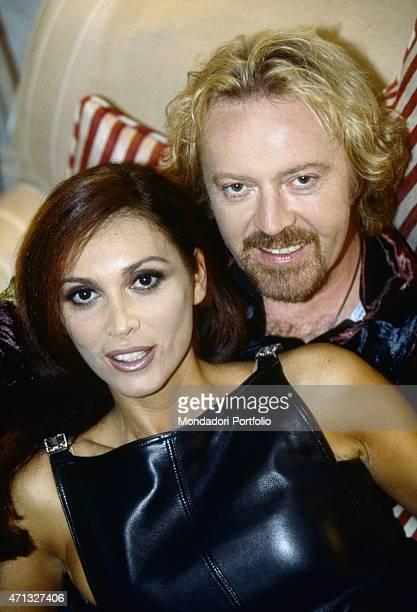 Italian singer-songwriter and guitarist Umberto Tozzi posing with his wofe and Italian model Monica Michielotto in a suite at the Blakes Hotel in the...