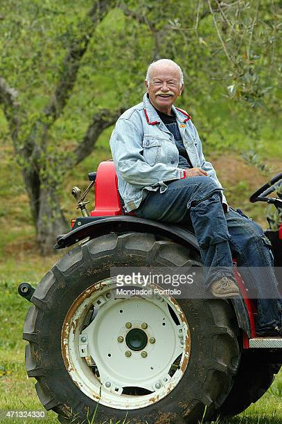 Italian singersongwriter and musician Gino Paoli smiling on a tractor in his farm in Maremma Campiglia Marittima 2007