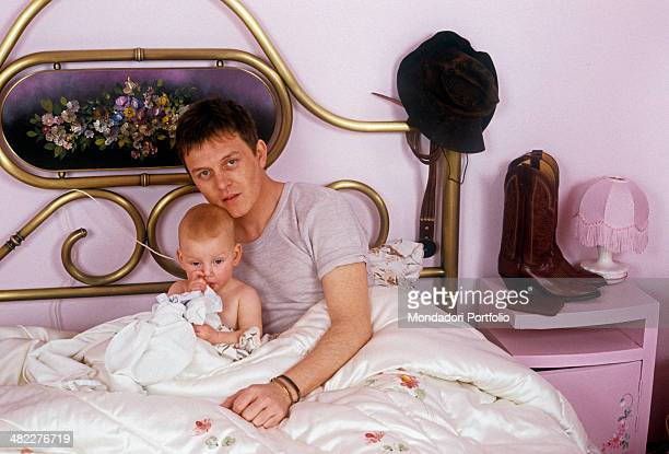 Italian singersongwriter and musician Zucchero posing in the bedroom with his daughter and Italian singer Irene Fornaciari Italy 1985