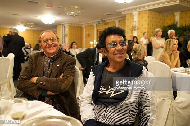 Italian singersongwriter and showman Renzo Arbore and Italian singersongwriter and guitarist Edoardo Bennato sitting smiling during the reception at...