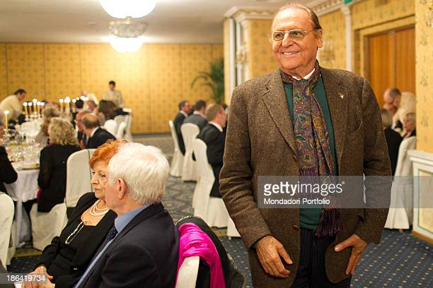 Italian singersongwriter and showman Renzo Arbore smiling during the reception at the hotel Parco dei Principi Italian actor and comedian Lino Banfi...
