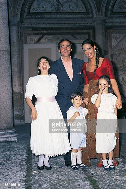 Italian singersongwriter and writer Roberto Vecchioni posing smiling in Villa Palestro with his wife Italian Journalist Daria Colombo in the day of...