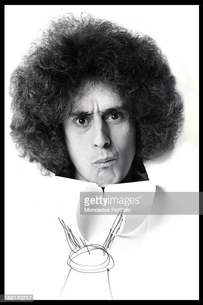 Italian singersongwriter Angelo Branduardi posing in a recording studio wearing a paper dress with a drawn tie Milan 1990
