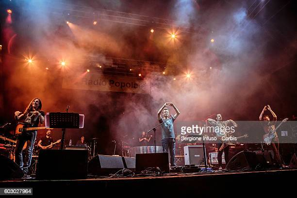 Italian singersongwriter Daniele Silvestri and Italian alternative rock band Afterhours perform live at CarroPonte in Milan Italy for an evening...