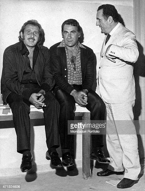 Italian singersongwriter Domenico Modugno Italian actor Alberto Lupo and Italian manager Ezio Radaelli posing together 1970s