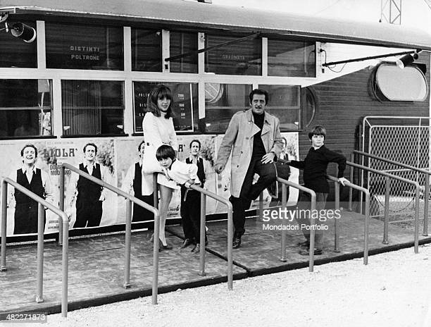 Italian singersongwriter Domenico Modugno italian actress Franca Gandolfi and their children Marco and Marcello posing outside the theatre where the...