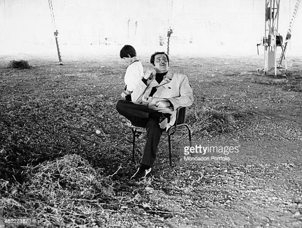 Italian singersongwriter Domenico Modugno sitting with his son Marcello under the big tent of a circus 1968