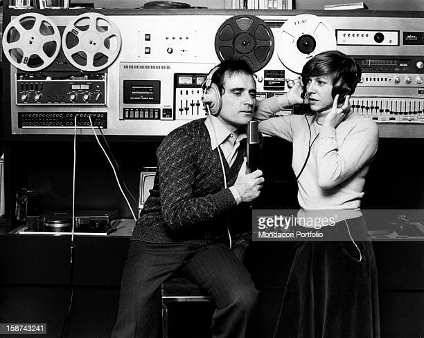 Italian singersongwriter Edoardo Vianello singing in a recording studio with his wife Italian singer Wilma Goich Together they form the band I...