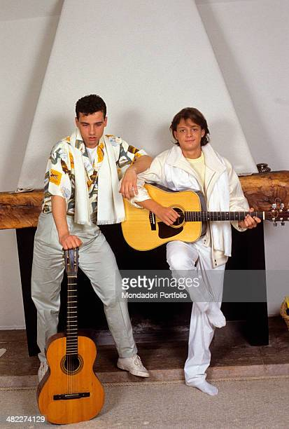 Italian singersongwriter Eros Ramazzotti and Mexican singer Luis Miguel posing with their guitars Italy 1985