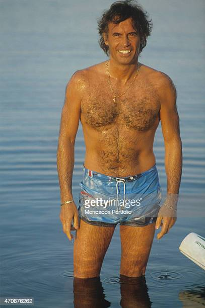 Italian singersongwriter Franco Califano posing in swimshorts 1981