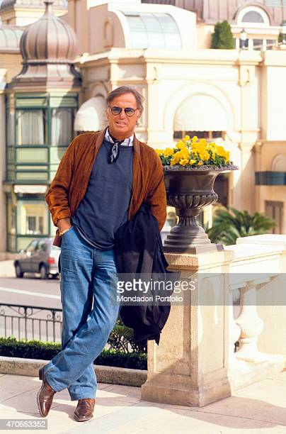 Italian singersongwriter Franco Califano posing leaned against a vase of flowers Monaco 1994