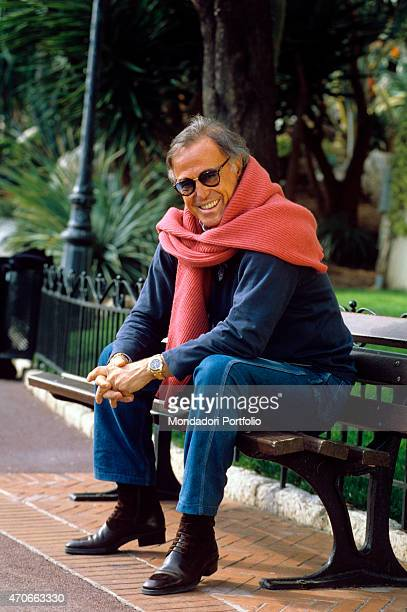 Italian singersongwriter Franco Califano posing seated on a bench Monaco 1994