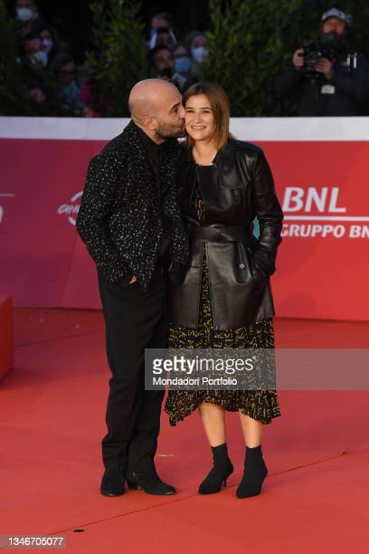 Italian singer-songwriter Giuliano Sangiorgi with his partner Ilaria Macchia, italian screenwriter, at Rome Film Fest 2021. The Eyes of Tammy Faye...