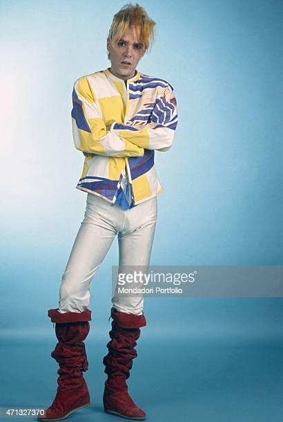 Italian singersongwriter guitarist and theatre artist Alberto Camerini posing wearing freakish clothing Italy May 1982