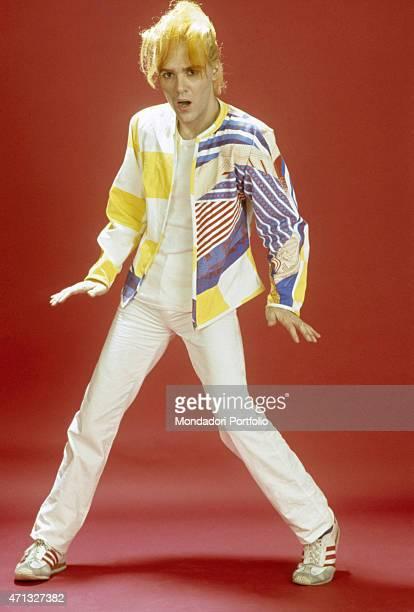 Italian singersongwriter guitarist and theatre artist Alberto Camerini posing while dancing Italy May 1982