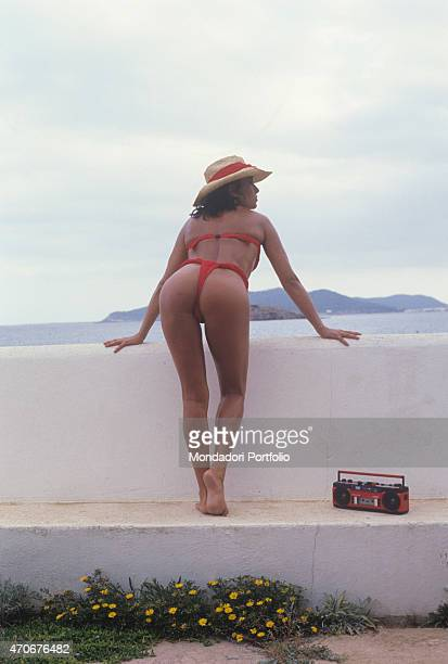 Italian singersongwriter Loredana Bert in string listening to the radio on a terrace 1988