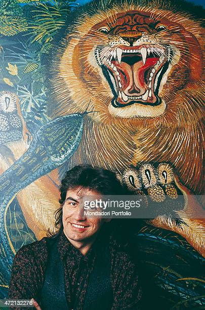 """Italian singer-songwriter Luciano Ligabue posing in front of a work by the painter bearing his same 'Il re della foresta''Il re della foresta'...."