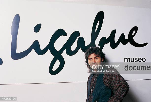 'Italian singersongwriter Luciano Ligabue posing in front of the banner of the Museo documentario e Centro Studi Antonio Ligabue at the Palazzo...