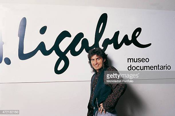 """Italian singer-songwriter Luciano Ligabue posing in front of the banner of the Museo documentario e Centro Studi Antonio Ligabue at the Palazzo..."