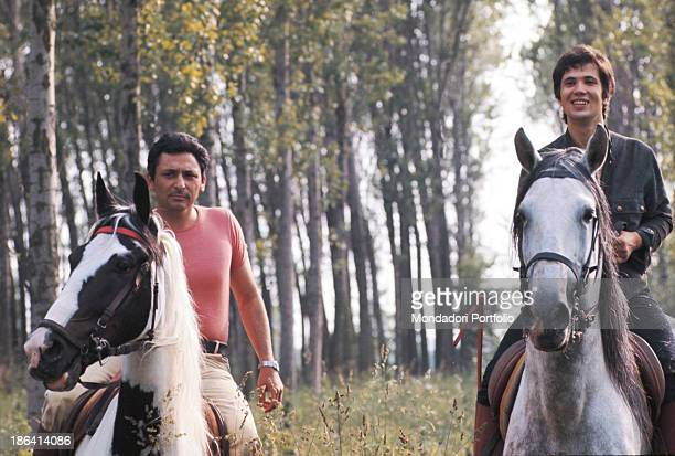 Italian singersongwriter Lucio Battisti and Italian lyricist Mogol riding their horses Battisti is going for a ride from Milan to Rome with his...