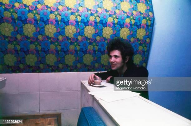 Italian singersongwriter Lucio Battisti drinking a Moroccan coffee in a bar Italy 1975