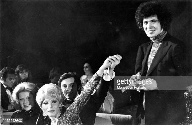 Italian singersongwriter Lucio Battisti guest of Swiss TV close to Mariolina Cannuli Donatella Moretti and Sergio Leonardi Switzerland January 1970