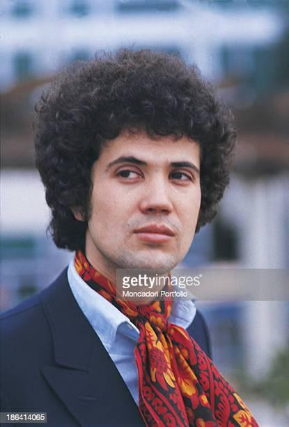 Italian singersongwriter Lucio Battisti posing with a neckerchief around his neck 1969