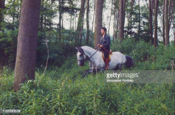 Italian singersongwriter Lucio Battisti riding a horse Battisti is going for a ride from Milan to Rome with his friend Mogol Italy 1970