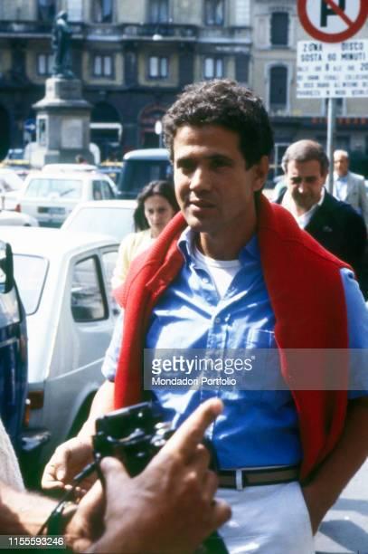 Italian singersongwriter Lucio Battisti walking along the street Milan 1982