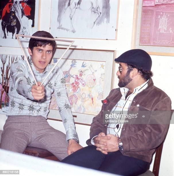 Italian singersongwriter Lucio Dalla is with Italian pop singer actor and entertainer Gianni Morandi at Morandi's house May 1969
