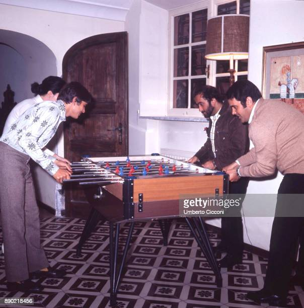 Italian singersongwriter Lucio Dalla plays foosball with Italian pop singer actor and entertainer Gianni Morandi and friends at Morandi's house May...