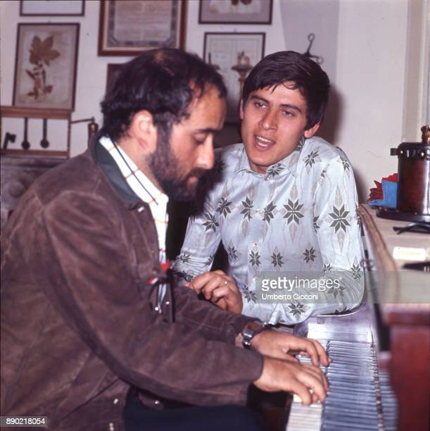 Italian singersongwriter Lucio Dalla plays the piano with Italian pop singer actor and entertainer Gianni Morandi at Morandi's house May 1969