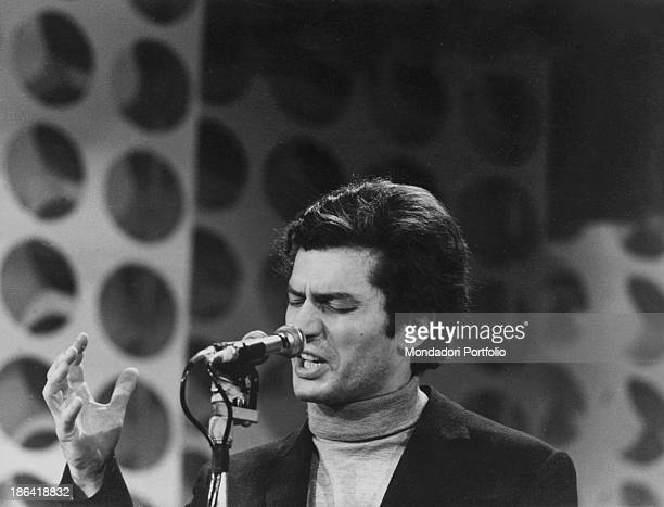 Italian singer-songwriter Luigi Tenco performing the song Ciao amore ciao during the 17th Sanremo Music Festival. Sanremo, 26th January 1967.