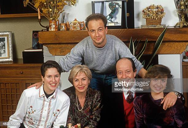 Italian singersongwriter Marco Masini posing together with his family 1990