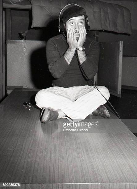 Italian singersongwriter musician and actor Lucio Dalla records a song in his studio Rome 1971