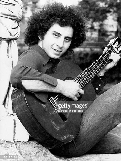 Italian singer-songwriter Paolo Frescura playing guitar. 1970s.