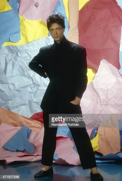 Italian singersongwriter Raf posing wearing a black suit and black loafers Italy 1984