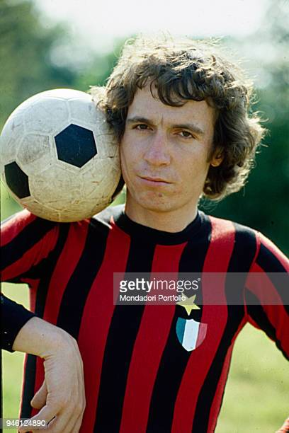 Italian singersongwriter Rino Gaetano posing with the AC Milan's new shirt with the star and the shield applied after the conquest of the 10th...