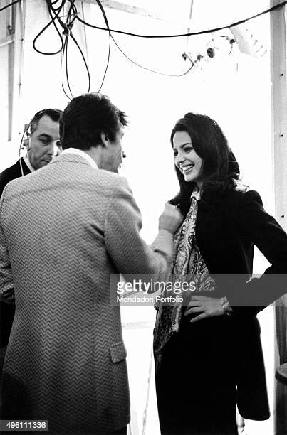 Italian singersongwriter Tony Renis talking with Italian actress and presenter Ira von Furstenberg during the 20th Sanremo Music Festival Sanremo...