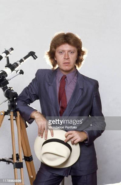 Italian singer-songwriter Umberto Tozzi leaning on a telescope. 1979