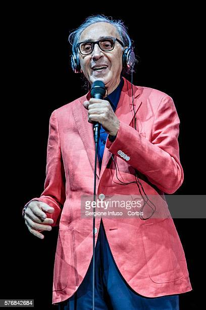 Italian singersongwriters composers Franco Battiato and Alice perform live with the Ensemble Symphony Orchestra at Assago Summer Arena for the Street...