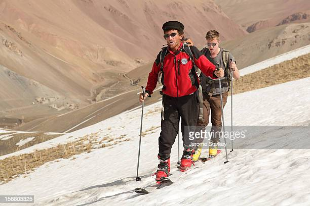 Italian ski guide Nando Rollando hikes up the slopes of Bamyan's Hindu Kush mountains The veteran mountaineer spent a winter in Bamyan province in...