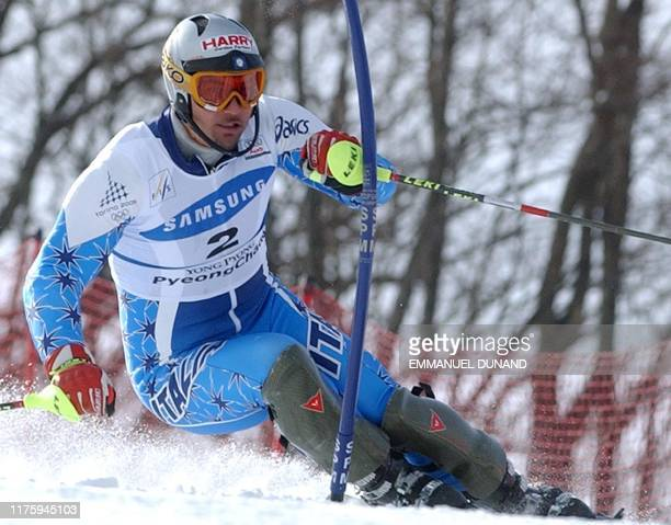 Italian skier Giorgio Rocca powers his way to second place 02 March 2003 in the World Cup Men's Slalom in Yongpyong some 250 kilometres east of Seoul...