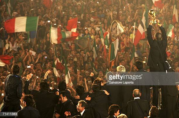 Italian soccer fans celebrate as the Italian team arrives with the FIFA World Cup Trophy at the Circo Massimo on July 10, 2006 in Rome, Italy.