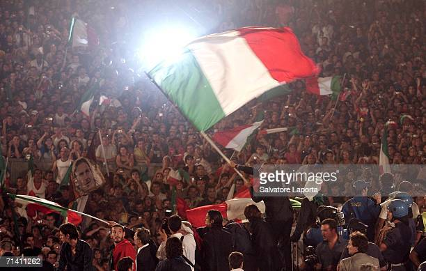 Italian soccer fans celebrate as the Italian team displays the FIFA World Cup Trophy at the Circo Massimo on July 10 2006 in Rome Italy