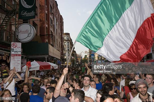 Italian soccer fans celebrate their team's victory over France on Mulberry Street in Little Italy July 9, 2006 in New York City. Italy won 5-3 in a...