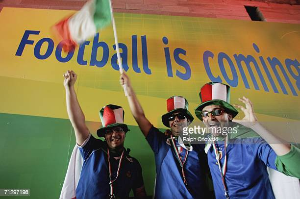 Italian soccer fans cheer in front of a placard before the World Cup match kickoff on June 26 2006 in Kaiserslautern Germany Italy will face...