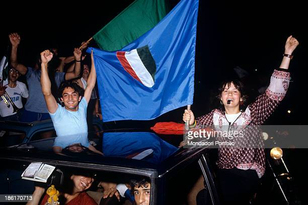 Italian soccer fans waves a blue flag with Italian Tricolore sticking out of cars' windows the Italy national football team is at the world...