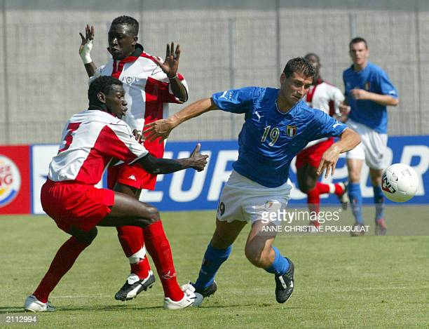 italian soccer Francesco Ruopolo is challenged by Burkina Faso's soccer Salif Nogo during a match in the 31th International Under 21 soccer...