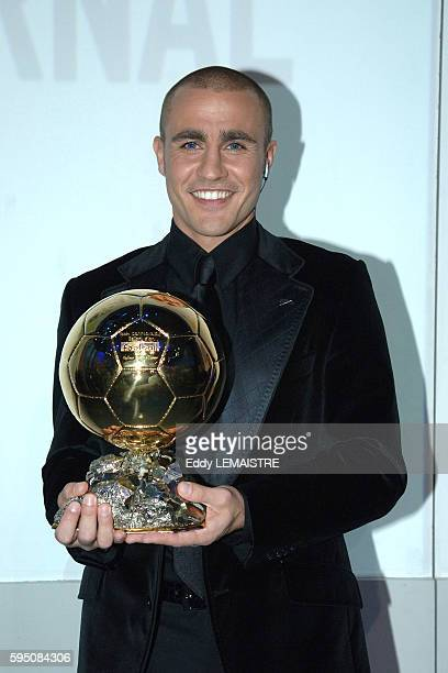 Italian soccer player of Real Madrid and captain of the Italian team that won the FIFA World Cup 2006 Fabio Cannavaro poses with the trophy of France...